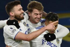 Goals from Stuart Dallas (left) and Patrick Bamford (centre) help Leeds United defeat Newcastle United 5-2 and register their first home win in the English Premier League for three months.