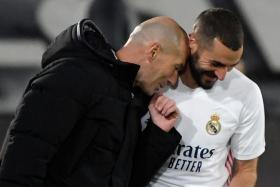 Real Madrid coach Zinedine Zidane (in black) describes Karim Benzema as phenomenal after the striker scores the opening goal and creates two others in the reigning La Liga champions' 3-1 win over Eibar.