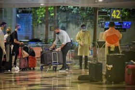 Singapore bars travellers from UK after new strain of virus detected