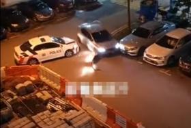 Two cops hurt, man nabbed after carpark mayhem