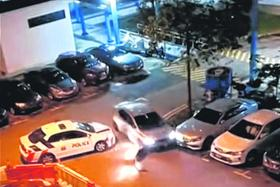 Man charged over carpark incident that injured two cops