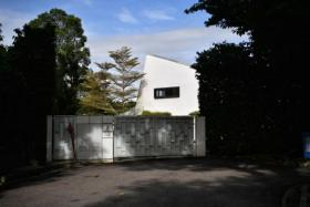 The 21,649 square foot bungalow is located a stone's throw from the Singapore Botanic Gardens.