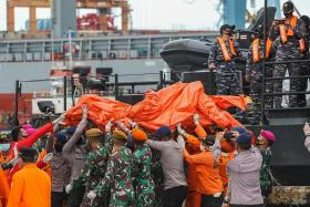 Distraught Indonesians wait for news of loved ones after plane crash