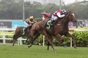 Jockey Oscar Chavez winning on In All His Glory.