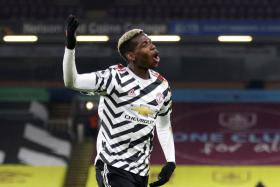 Paul Pogba celebrates after scoring the winner against Burnley.
