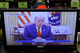 Two hours after historic second impeachment, Trump preaches peace