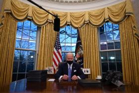 US virus deaths top WWII fatalities as Biden warns worst yet to come