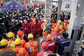 Eleven miners in China rescued after 14 days underground