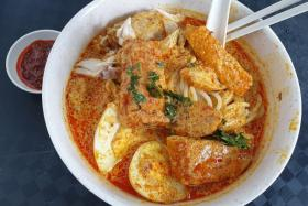 Mr Koh Seng Choon, is the founder of Dignity Kitchen in Boon Keng Road, a foodcourt managed by people with disabilities who whip up local favourites like laksa (above), kolo mee and claypot rice.