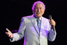 In this file photo taken on August 08, 2019 US singer Tony Bennett (Anthony Dominick Benedetto) performs on stage during an invitation only concert at the newly opened Encore Boston Harbor Casino in Everett, Massachusetts.