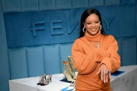 In this file photo taken on February 8, 2020 US pop singer Robyn Rihanna Fenty celebrates the launch of FENTY at Bergdorf Goodman in New York City.