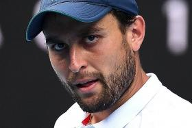 Debutant Aslan Karatsev to face Novak Djokovic in semis