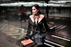 In this file photo US actress Demi Moore presents a creation of British designer Kim Jones for the Fendi's Spring-Summer 2021 collection during the Paris Haute Couture Fashion Week, in Paris, on January 27, 2021.