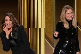 Hosts Tina Fey (L) and Amy Poehler are seen in this handout screen grab from the 78th Annual Golden Globe Awards, in Beverly Hills, California, U.S., February 28, 2021.