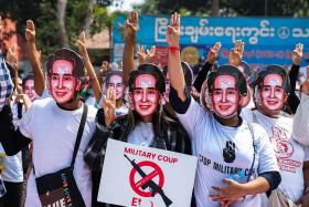 Two more charges filed against Suu Kyi as cops crack down on protests