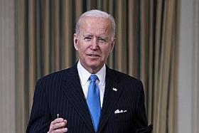 Biden slams 'Neanderthal' decisions to end mask mandates