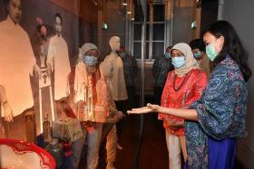 President Halimah visits galleries showcasing Singaporean women