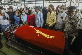 Official from Suu Kyi's party dies in police custody