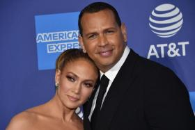 In this file photo taken on January 2, 2020 US actress Jennifer Lopez (L) and partner US former baseball player Alex Rodriguez arrive for the 31st Annual Palm Springs International Film Festival (PSIFF) Awards Gala at the Convention Center in Palm Springs, California.
