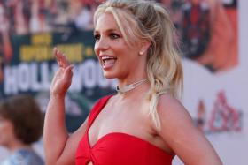 """Britney Spears poses at the premiere of """"Once Upon a Time In Hollywood"""" in Los Angeles, California, U.S., July 22, 2019."""