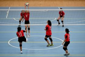 Fairfield Methodist School (Secondary) and Peicai Secondary School's B Division volleyball teams in action at Our Tampines Hub yesterday.