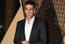 In this file photo taken on January 25, 2019 Indian Bollywood actor Akshay Kumar poses for a picture during the wedding reception of film producer Mukesh Bhatt's daughter Sakshi Bhatt (not pictured), in Mumbai.