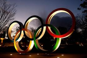 Japan denies giving Olympic athletes priority for vaccine