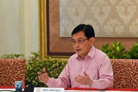 DPM Heng steps aside as 4G leader for younger successor