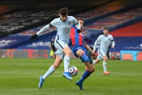 Chelsea's Kai Havertz (in white) fending off a challenge from Crystal Palace's Gary Cahill.