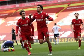 Trent Alexander-Arnold (No. 66) celebrates with Xherdan Shaqiri after scoring Liverpool's winner against Aston Villa.