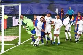 Barcelona coach Koeman furious with referee in Clasico loss to Real