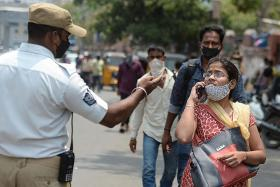 India reports a record daily tally of 168,912 new infections