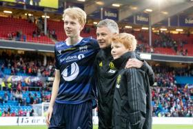 Manchester United manager Ole Gunnar Solskjaer poses with his two sons - Noah, who plays for Kristiansund, and Elijah - during a friendly match with the Norwegian side in 2019.