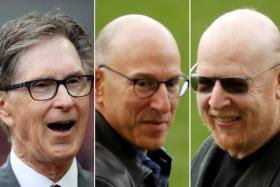 From left, Liverpool owner John Henry and his Manchester United counterparts Joel and Avram Glazer.