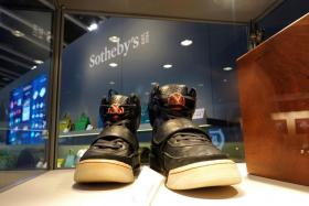 A pair of 'Nike Air Yeezy 1' prototype sneakers designed by Kanye West, are displayed at the Hong Kong Convention and Exhibition Centre before going up for private sale at Sotheby's, in Hong Kong, China April 16, 2021.