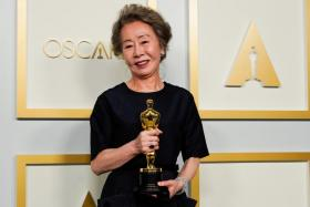 """Youn Yuh-Jung, winner of the award for Best Actress in a Supporting Role for """"Minari"""", poses at the press room of the Oscars, in the 93rd Academy Awards in Los Angeles, California, U.S., April 25, 2021."""