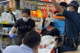 The woman was taken to Ng Teng Fong General Hospital. She had injuries to her hands and neck.