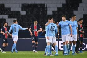 Manchester City's players celebrate after winning the UEFA Champions League first leg semi-final football match between Paris Saint-Germain