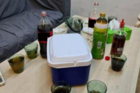 Alcohol found in an office unit in Ubi Road 2 on Saturday. Five men and eight women were allegedly drinking and socialising.