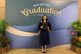 National table tennis champion Tan En Hui, 21, graduated with a diploma with merit in business studies yesterday.