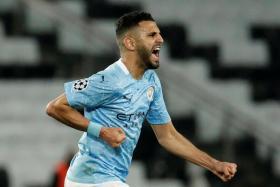 Riyad Mahrez celebrates after scoring Manchester City's second goal.