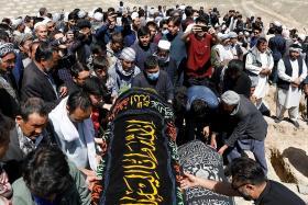Dozens of girls buried after blast outside school in Afghanistan