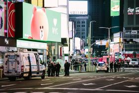 Times Square shooting leaves three hurt, including child in stroller