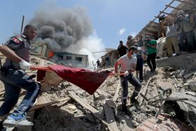 Palestinians evacuating a body from one of the sites of Israeli strikes in Gaza.