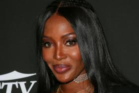 In this file photo British model Naomi Campbell arrives for the 10th Anniversary CORE (Community Organized Relief Effort) Gala at the Wiltern theatre in Los Angeles on January 15, 2020.