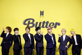 Members of K-pop boy band BTS pose for photographs during a photo opportunity promoting their new single 'Butter' in Seoul, South Korea, May 21, 2021.