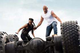 Vin Diesel (right) and Nathalie Emmanuel in Fast & Furious 9