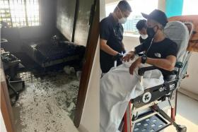 Most of the furniture in the tenant's room were burned in the fire, the cause of which is under investigation. (Above, right) Mr Muhammad Nasiruddin Md Khalid was taken to hospital after the incident.