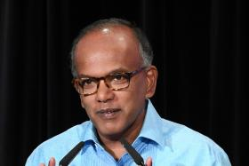 Imposing racial view on others crosses the line: Shanmugam