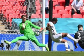 Raheem Sterling (in white) scoring England's winner.